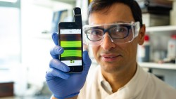 30096 Nuno Reis and e-coli Detection 23 Dec 2019. Dr Nuno Reis is researching a technique to detect the presence of e-coli using smart phone technology. Shots of Nuno in lab with equipment.  Client: Will McManus - Comms