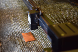 A laser prepares to texture the surface of copper, enhancing its antimicrobial properties. (Purdue University photo/Kayla Wiles)