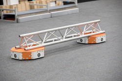 """The Fraunhofer Institute for Material Flow and Logistics IML is developing a new generation of automated guided vehicles. """"LoadRunners"""" use artificial intelligence and communicate via 5G to organize themselves as a swarm and execute jobs independently. Able to sort large quantities of packages, this high-speed transporter can serve booming online and mail-order businesses well."""